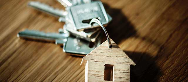 keys with a wooden key-chain with a house shape