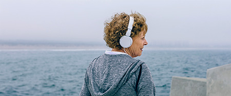 Senior woman headphone.