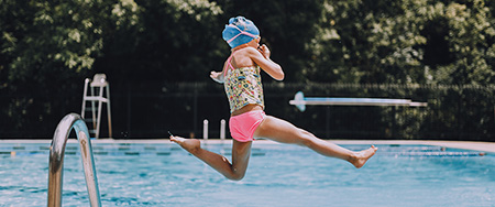 Girl diving into pool.